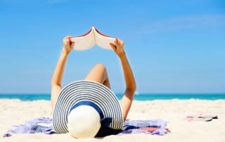 Photo of a Woman on Port Aransas Beach Doing Some Summer Reading.